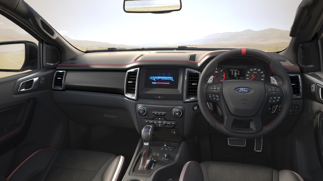 The red stitching and blackout elements are exclusively on the interior of the Ford Ranger Raptor X.  Photo: Ford