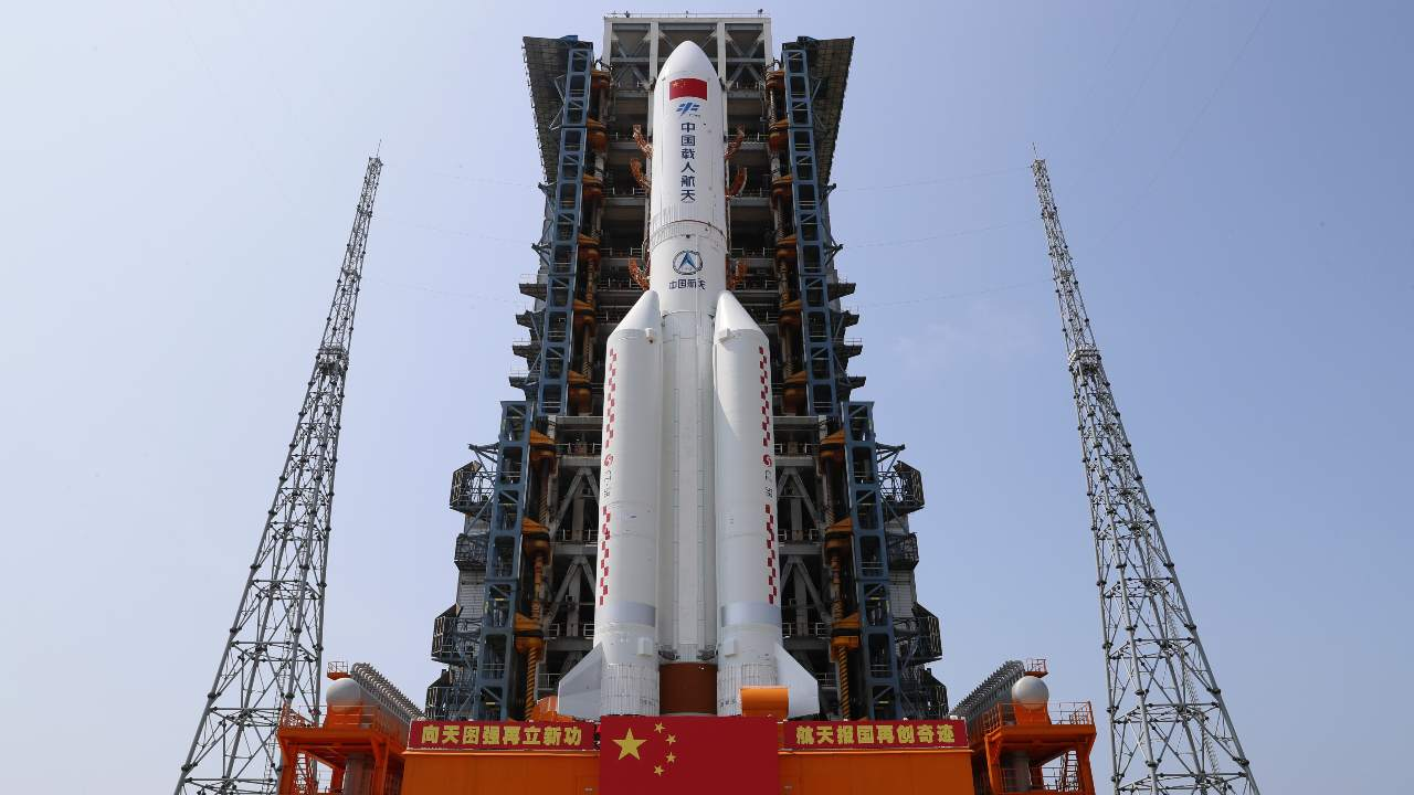 In this photo, published by Xinhua News Agency, China's Tianhe nuclear module Long March-5B Y2 rocket will be transferred to the Wenchang spacecraft launch site in Hainan Province, southern China on April 23, 2021. China plans to launch the first permanent space station nuclear module this week, the latest big step for the space research program.  Photo credit: Through Guo Wenbin / Xinhua AP