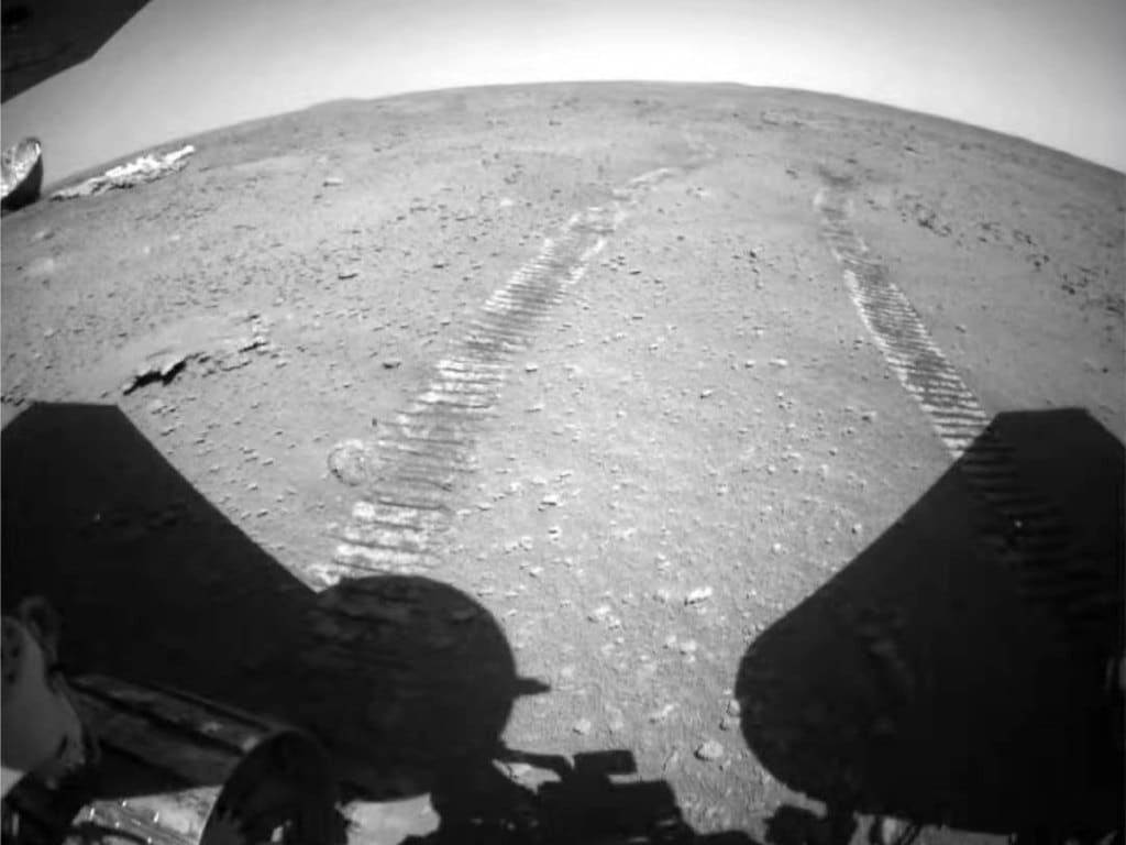 Zhurong tracks on Mars.  China National Space Administration