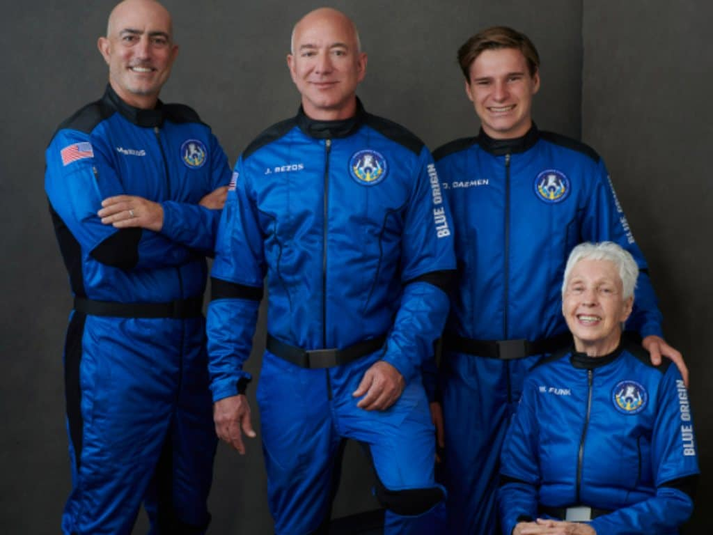 Mark Bezos, Jeff Bezos, Oliver Daemon and Wally Funk pose in their bright blue flight suits. Image credit: Twitter/ @blueorigin