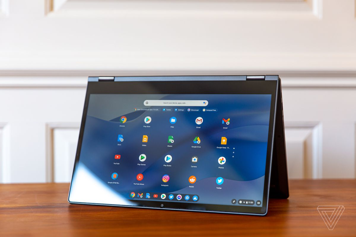 Lenovo Flex 5 Chromebook in tent, corner left.  The screen shows a grid of Chrome OS icons on a blue wavy background.