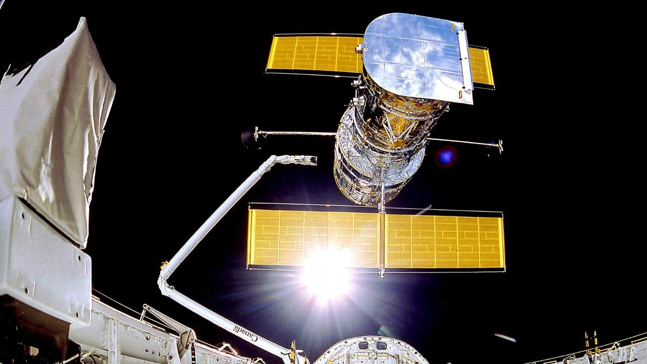 The Hubble Space Telescope will be shipped on April 25, 1990 from the space shuttle Discovery.  To avoid atmospheric distortions, Hubble has an unobstructed view of planets, stars, and galaxies more than 13.4 billion light-years away.  Scope: NASA / Smithsonian Institution / Lockheed Corporation