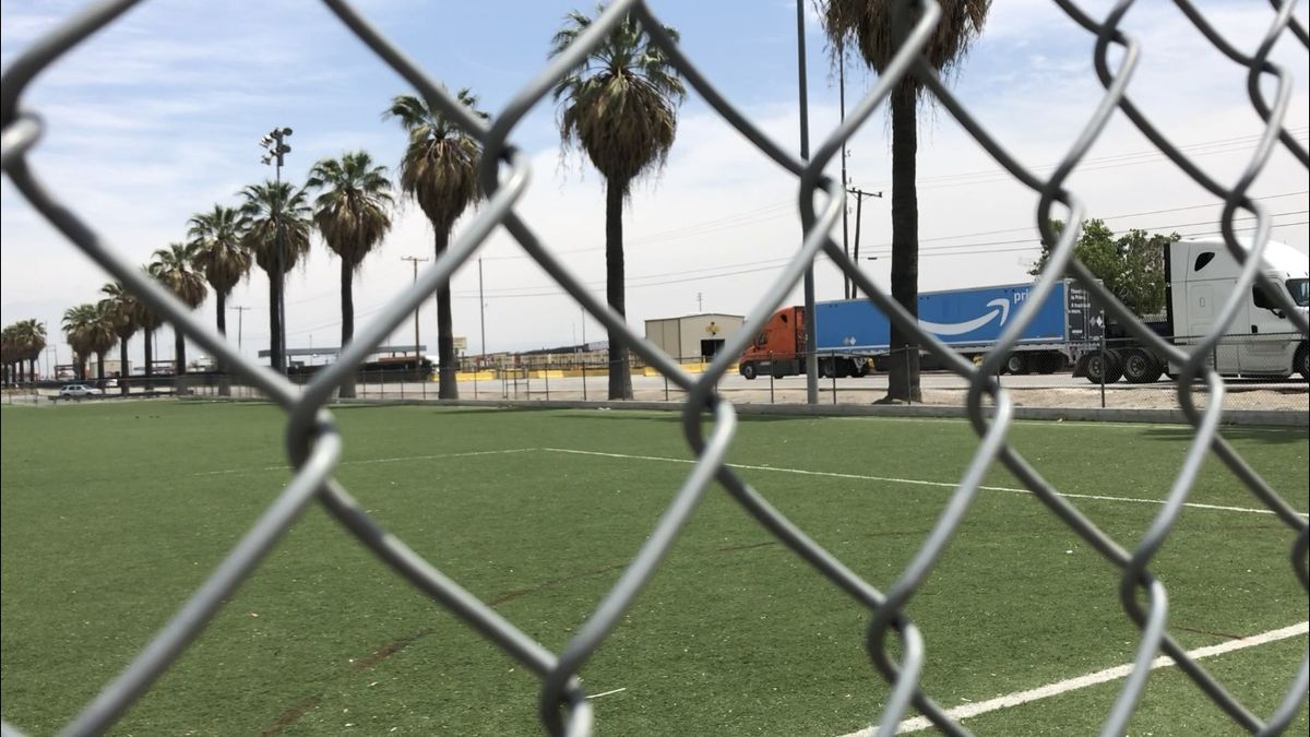 An Amazon Prime truck drives to the BNSF railway yard.  The railroad yard is located across the street from the soccer field and community center in San Bernardino, California and attracts steady truck traffic.