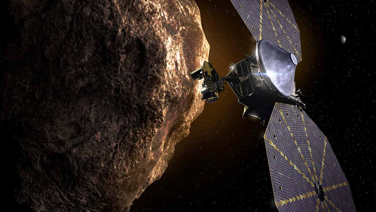 The artist's perception of the Lucy spacecraft in the Trojan asteroid.  Photo: NASA